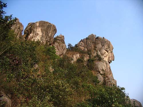 Roca del Leon - El ojo de la Roca del León en Hong Kong cambia misteriosamente de color