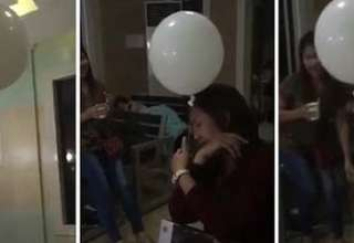 fantasma nino consolando globo velatorio 320x220 - Video muestra el fantasma de un niño consolando a su madre con un globo en un velatorio
