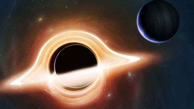 enorme agujero negro - Un misterioso objeto espacial oscurece un enorme agujero negro, y nadie sabe que es